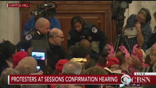 Protesters chant, interrupt Sessions during his opening statement at confirmation hearing for attorney general
