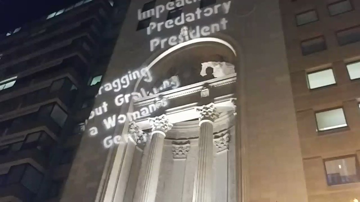 'Impeach predatory president' projected onto National Press Club as #D...