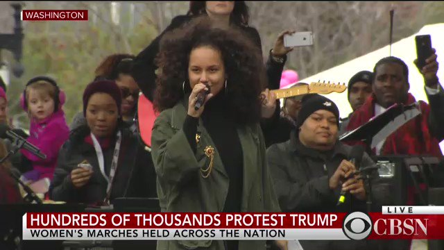 'These girls are on fire,' sings Alicia Keys while walking the stage at #WomensMarch rally https://t.co/TgJ6U199TR