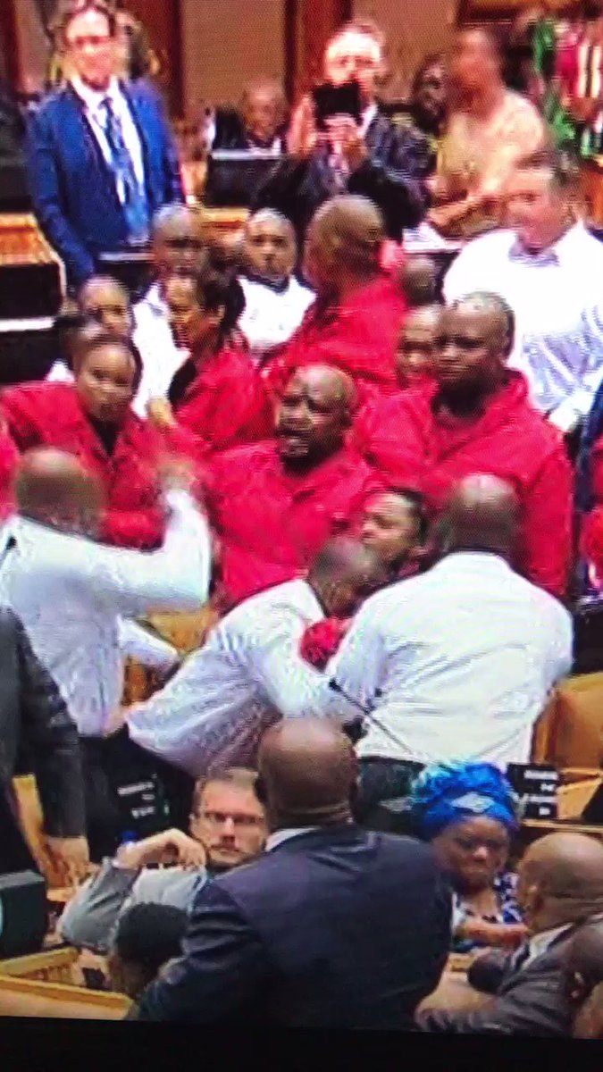 Violence in the house. Parliamentary security services forcefully remove EFF MPs who fight back with their hats https://t.co/qVG9zrQKjT