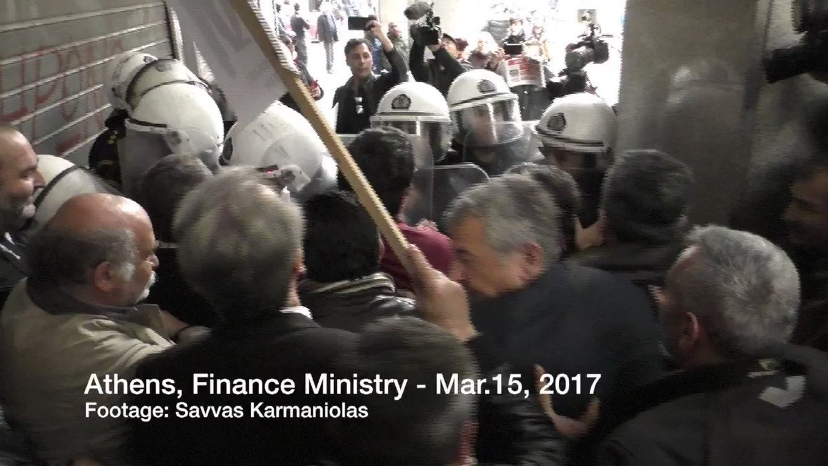 Tension between workers in public hospitals and police outside the Finance Ministry in Athens