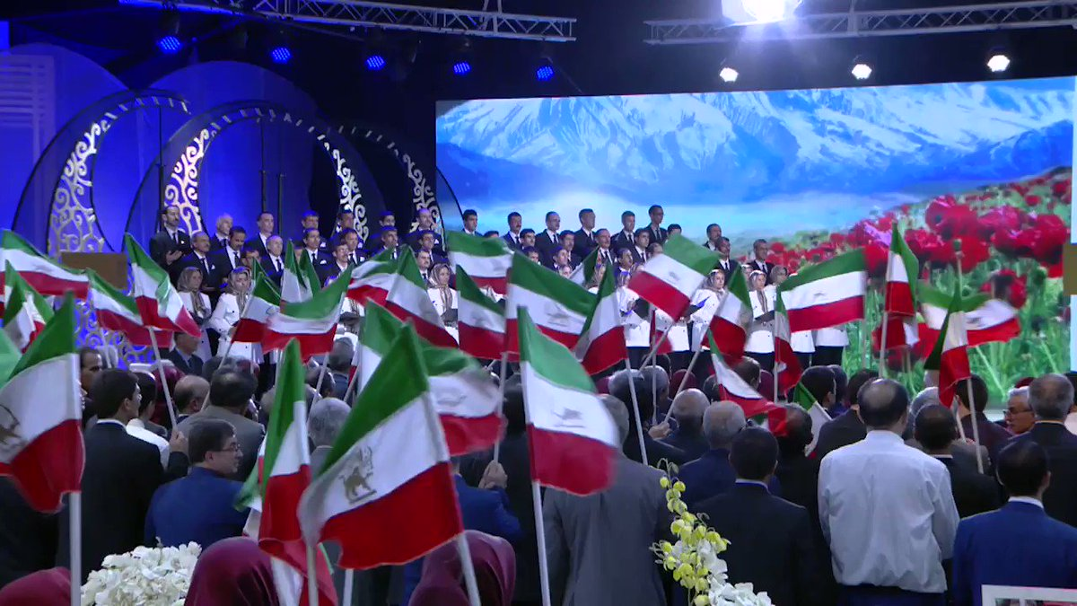 Maryam Rajavi listens as the national #Iran ian anthem is played at #Nowruz ceremony #FreeIran