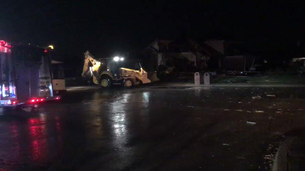 Backhoe begins to clean up storm damage in Rockwall's Dalton Ranch com...