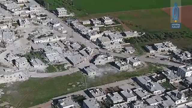 Drone footage showing SAA Tiger Forces and Hezbollah fleeing en masse with 20+ vehicles, incl. 1 tank, 2 BMPs and dozens more on foot from Maardes after 9 hours of clashes with Syrian rebels, northern Hama, Syria.