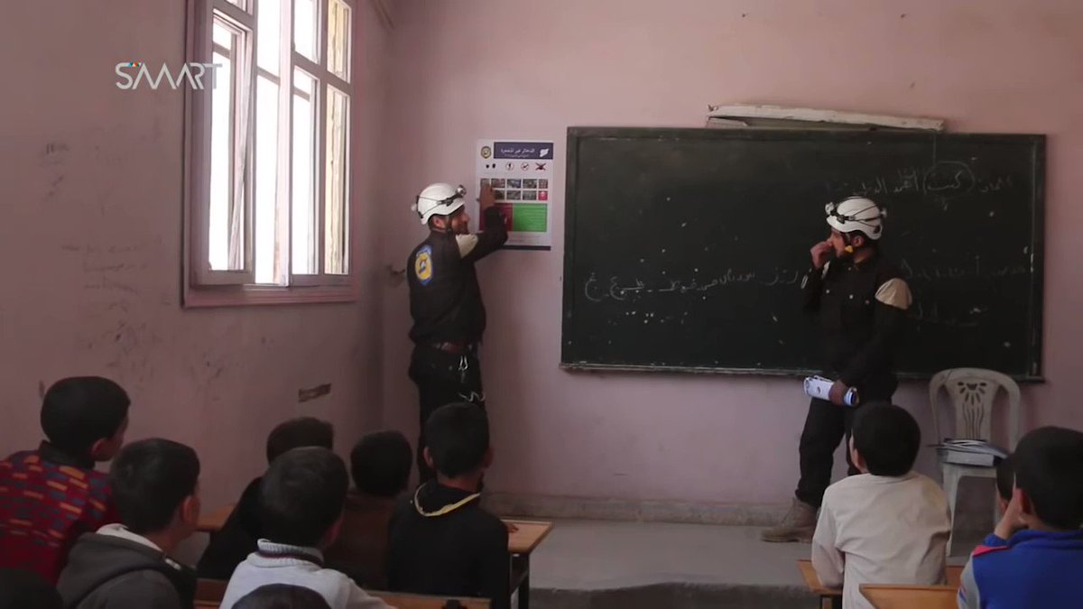 White Helmets volunteers educate Syrian kids on dangers of mines/IEDs during an awareness campaign in (Turkish-backed) Syrian rebel-held al-Bab.