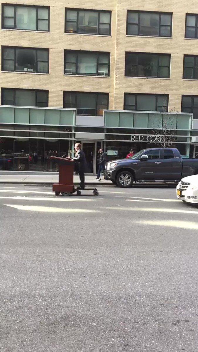 Melissa McCarthy is casually cruising through Midtown on Sean Spicer's podium