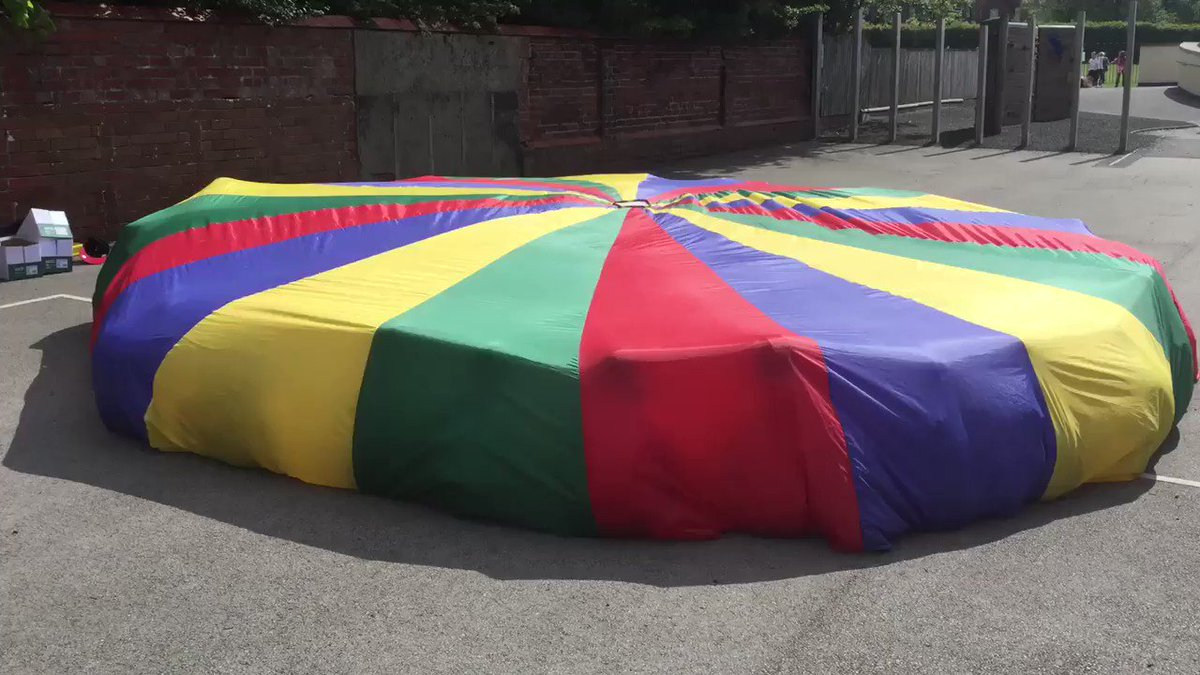 Mrs Drivers' class loved singing French songs outside and under a parachute! Tres bien!
