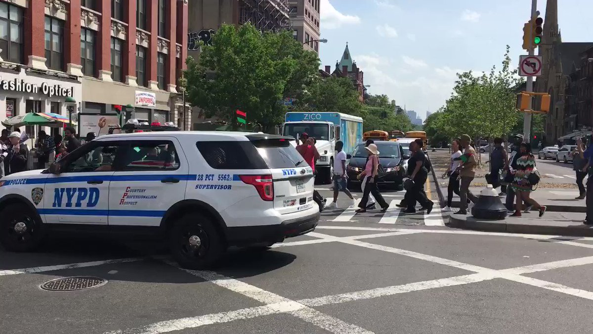 Protesters have shut down 125th street and MalcolmX boulevard in Harlem for #MalcolmXDay