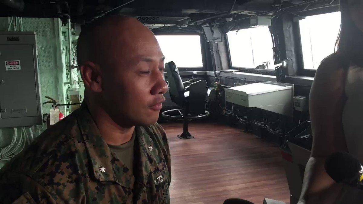 US Marine Corps Lt Col Jackson Doan speaks on board USS Green Bay