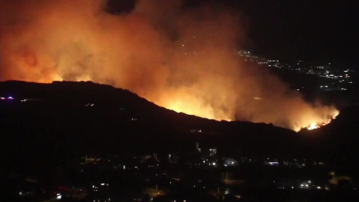 WATCH LIVE: Camp Pendleton brush fire burns into night as flames light...
