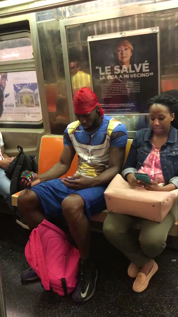 Subway wizard barely pays attention to the Rubik's Cube he solves with one hand