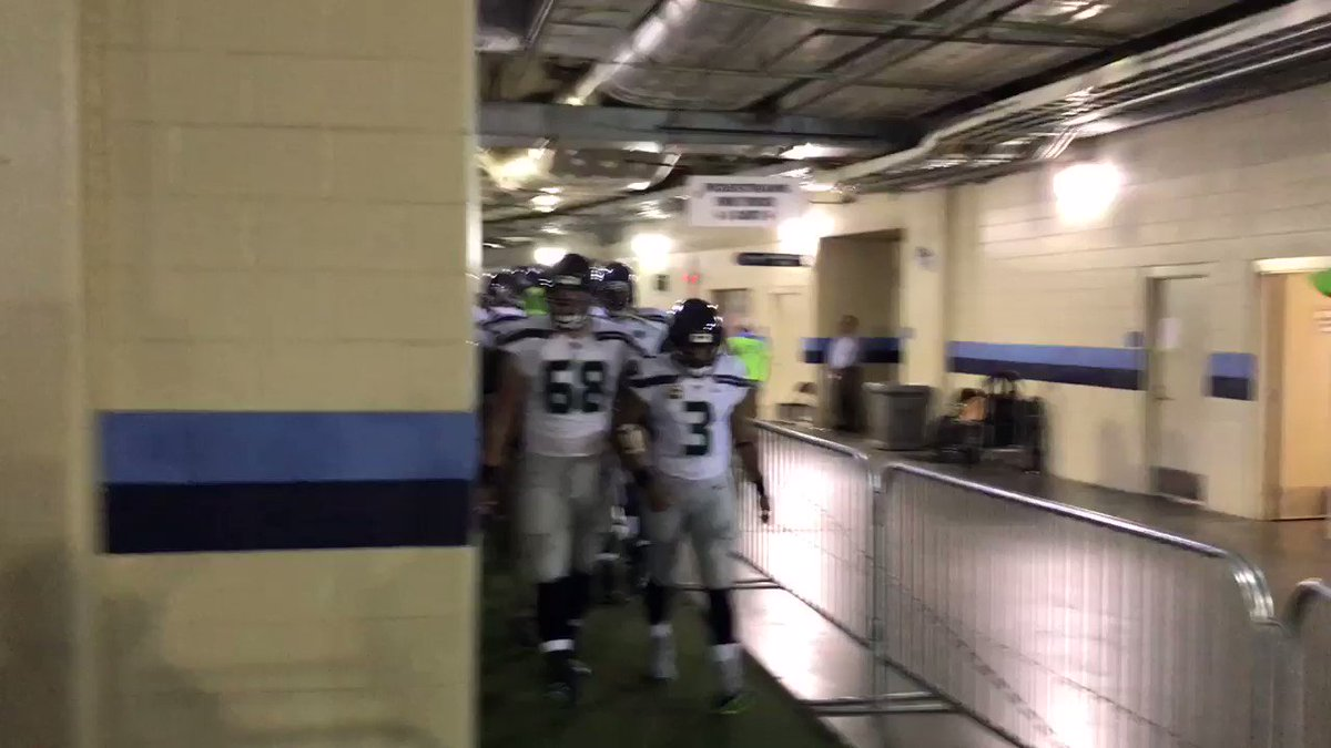 Players come out of locker room arm in arm after National Anthem finis...