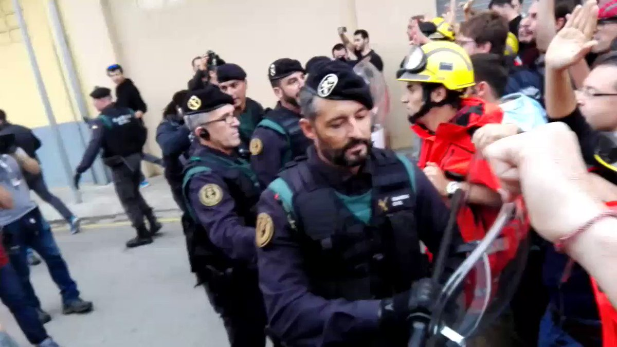Catalan firefighters defending voters from the Spanish police. Absolutely astonishing.