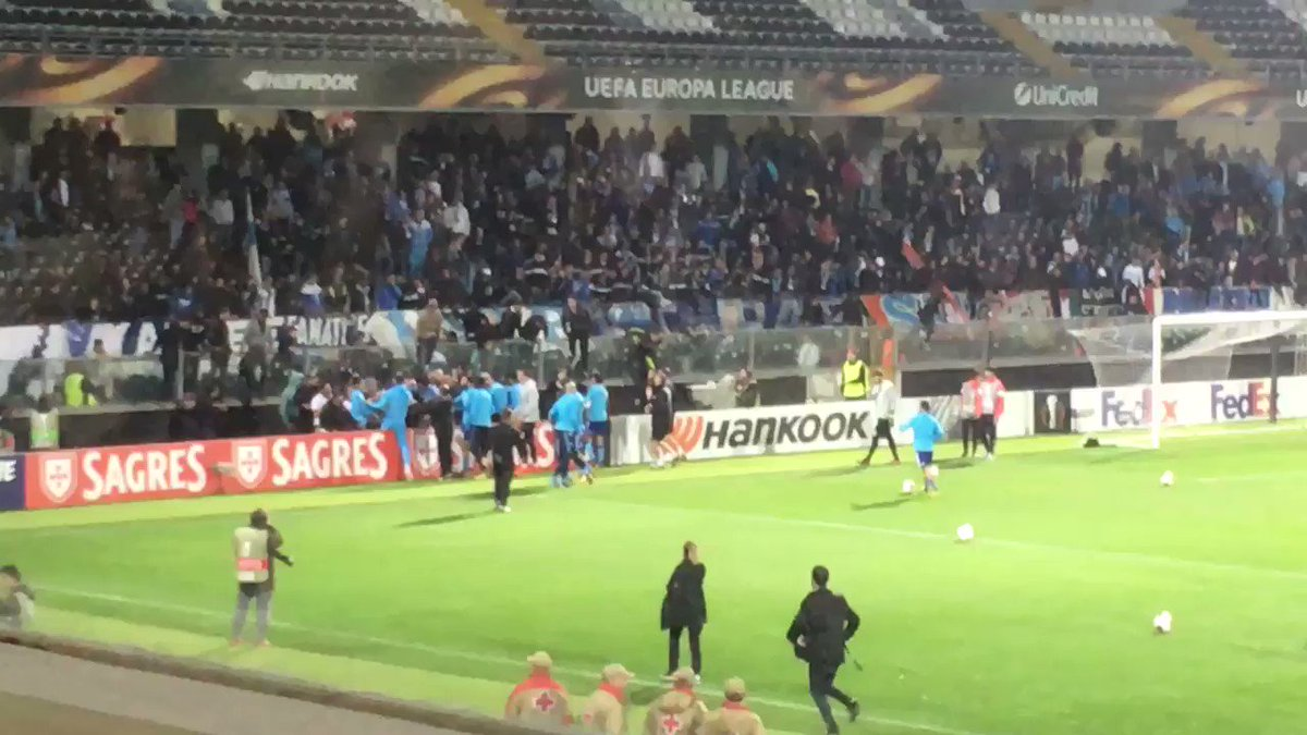 Marseille's Patrice Evra sent off after aiming kick at fan