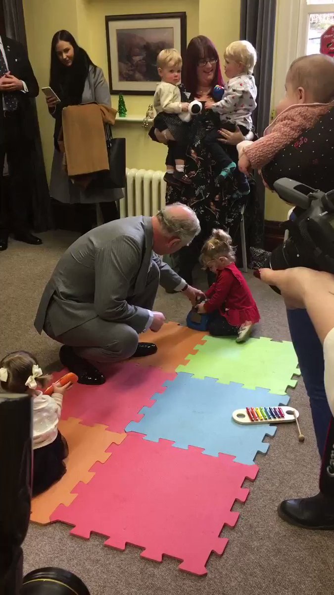 The Prince of Wales meets the children and leaders at the Stay and Play group in Caerphilly... and can't resist joining in with the fun! 🚘