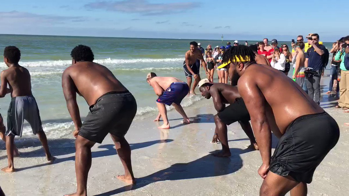 Watching Michigan play football on the beach will make you so jealous