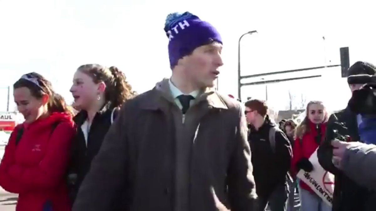 Mayor Jacob Frey marches with Minneapoli...