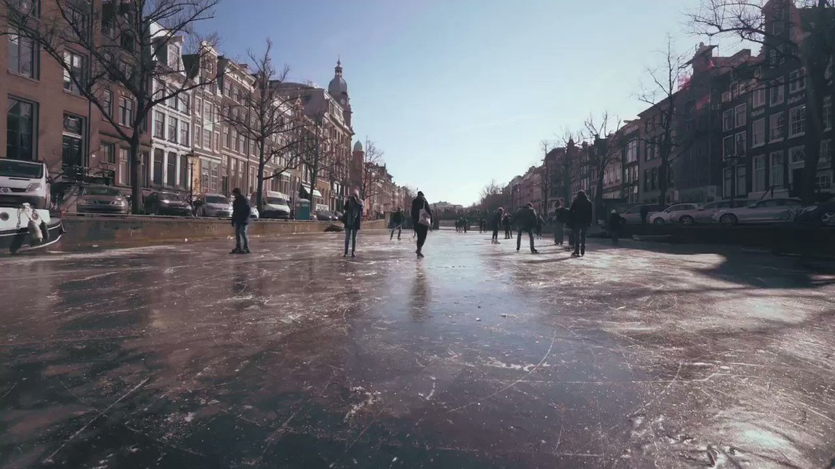 Ice skaters take to Amsterdam's canals during Europe's big freeze