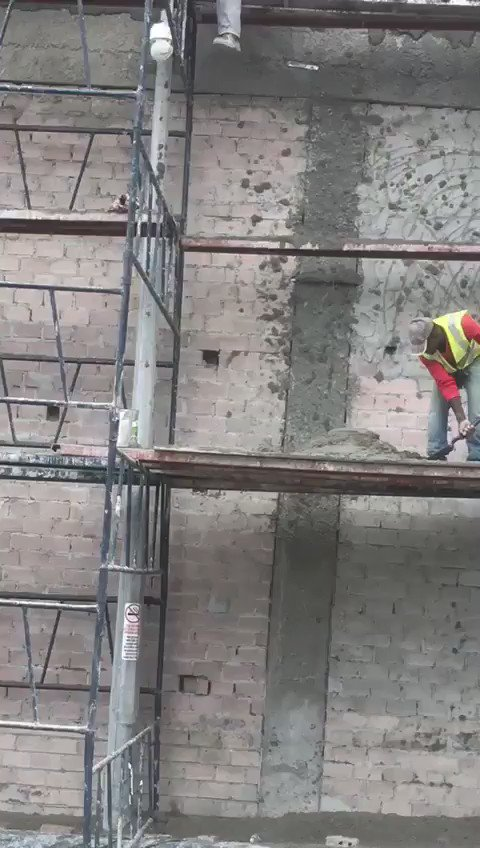 How these guys plaster a wall on a highrise. Quite something to watch.   Via @aj_jandu https://t.co/78hqGA2idZ