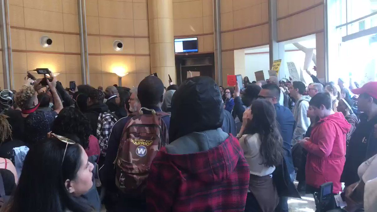 Image for the Tweet beginning: Protestors chanting inside city hall