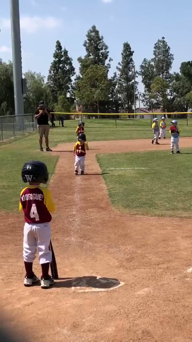 This kid's slow-mo run to home plate is a piece of baseball art