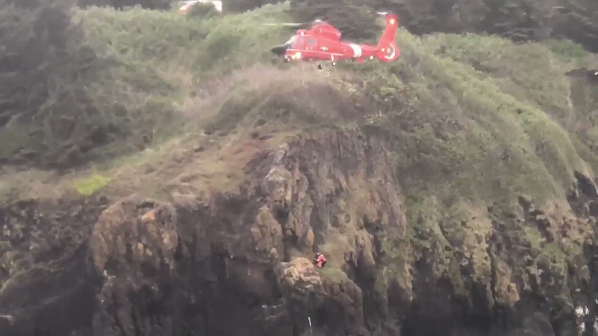 District thirteen searchandrescue uscg aircrew from air facility newport rescues surfer stuck on cliffside may 13 httpstkdej4scjgm publicscrutiny Gallery