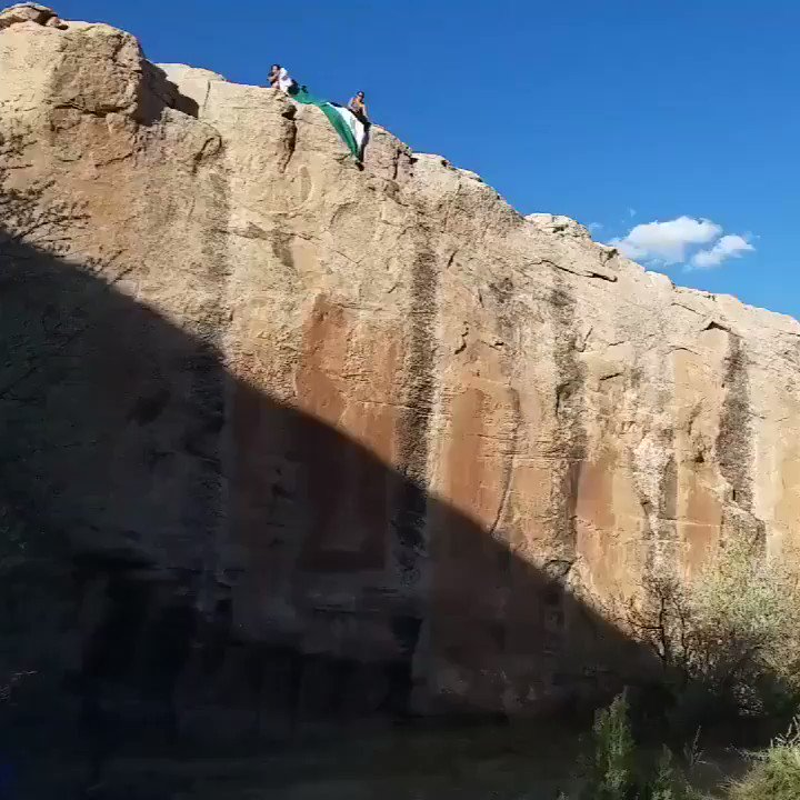 Members of The Red Nation expressed their solidarity with Palestinians and their struggle for freedom by dropping a large Palestinian flag from a 100 ft cliff in Window Rock, the capital of Navajo Nation. [Video via @The_Red_Nation ]