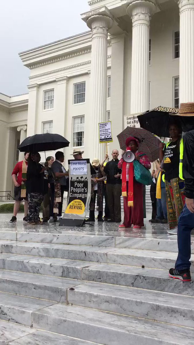 """At the #PoorPeoplesCampaign rally outside the Alabama State Capitol, """"We ain't gonna let no rain turn us round."""""""