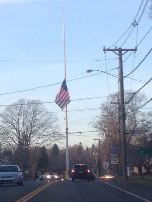 A flagpole flies at half-mast in #Newtown, Connecticut. Photo: Kyle Lyddy. http://abcn.ws/UMG79i http://pic.twitter.com/bj31RN7N