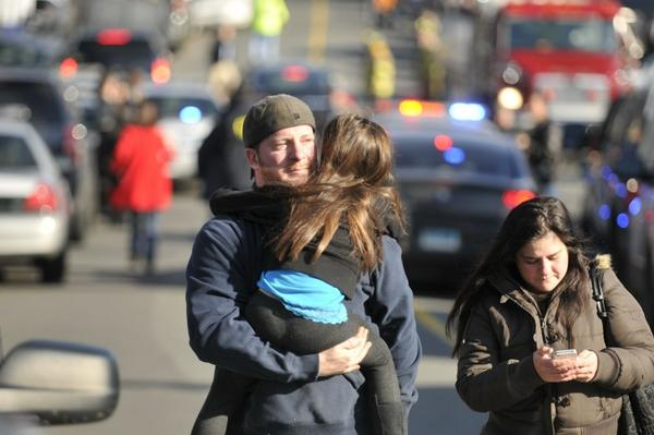 Parents leaving a staging area after a shooting at the Sandy Hook Elementary School. http://pic.twitter.com/yNd2hUqJ