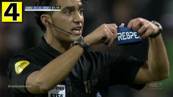 LOLZ! Dutch referee Serdar Gözübüyük cautions Groningen coach Robert Maaskant with his 'Respect' armband