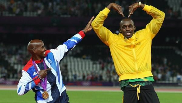 Pic: Legends! @Mo_Farah does 'The Bolt' while @UsainBolt does 'The Mo-Bot' http://t.co/x37kdSiP