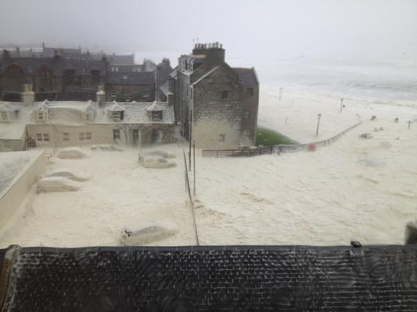 Amazing pic taken of sea foam drifting into streets of Aberdeen from the Seacroft marine's office http://news.stv.tv/north/191736-flood-warnings-issued-as-rain-and-winds-of-up-to-70mph-batter-scotland/ http://pic.twitter.com/DKyd0Fu5