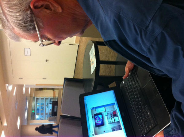 Mr. Day looking at the live Twitter feed and Instagrammed photos from the lobby #SwedishHear http://pic.twitter.com/60CP6wzX