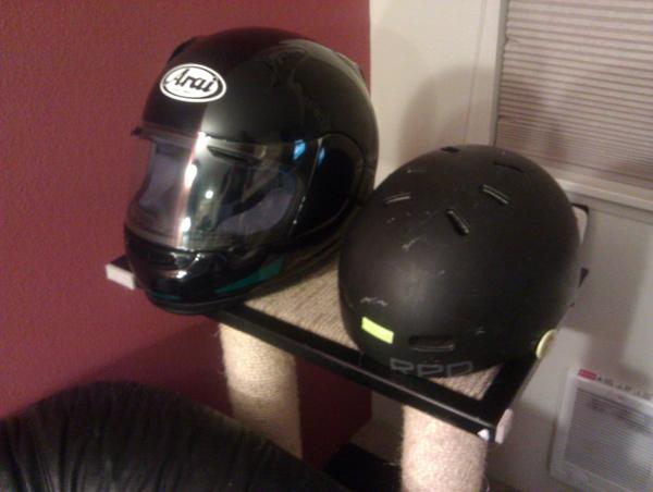 Bicycle helmet and motorcycle helmet on a cat tree