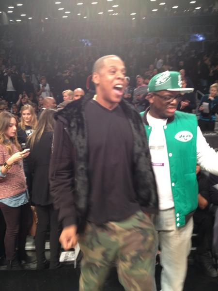 "Jay Z looks fired up as his Nets take the floor. says its ""surreal"" to have a pro squad in Brooklyn, finally http://pic.twitter.com/wNAcKHXU"