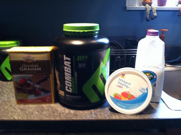 1cup of lf milk; 11/4 scoop of cookies & creme whey; 6 icy bed; 2 choco graham crackers; 1/4 cup lowfat creme