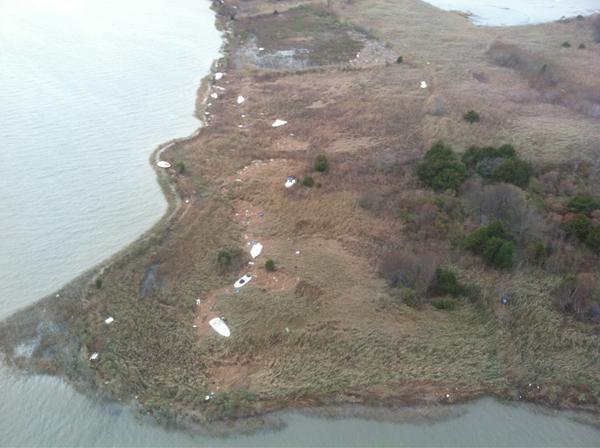 Boats tossed from marina onto small island near Ship Bottom. #sandyNJ http://pic.twitter.com/ohTmS3py
