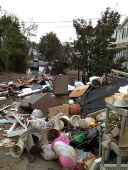 Piles of water-logged belongings line the streets in this Rookie's Staten Island neighborhood. Hear her story on @WNYC http://pic.twitter.com/dmRjWVOg