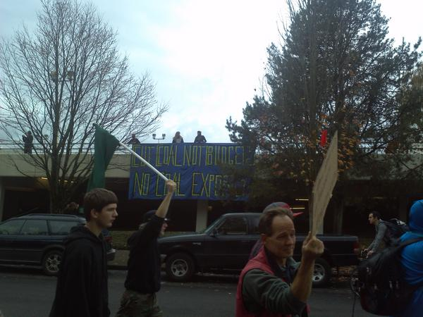 March east on Halsey.  Banners dropped & people in parking garage cheering.  #OccupyGresham #OPDX #N3 #NoAusterity http://pic.twitter.com/fz2ZYUcT