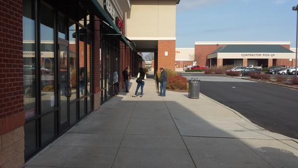 The line outside Great Clips is 4x the length of the Wii U line where, 2 minutes before GameStop opens I'm still alone. http://pic.twitter.com/rNhP70AL