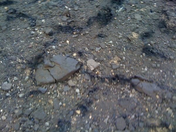 This is what the surface of I-77 looks like after the fire.  The heat caused it to crumble. http://pic.twitter.com/iSymZwXH