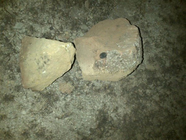 These are examples of the size of rocks that were laying on I-77. That's a quarter on top of the rock on the right http://pic.twitter.com/iVSaIU3Y