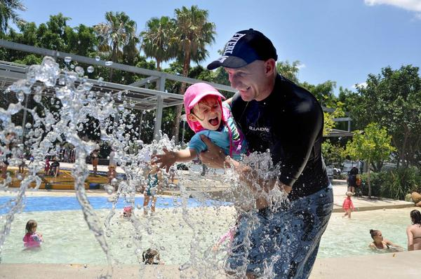 Heaps of people beating the Brisbane #heatwave at South Bank beach. Here's Brent and Tia http://pic.twitter.com/9ZDumKZ7