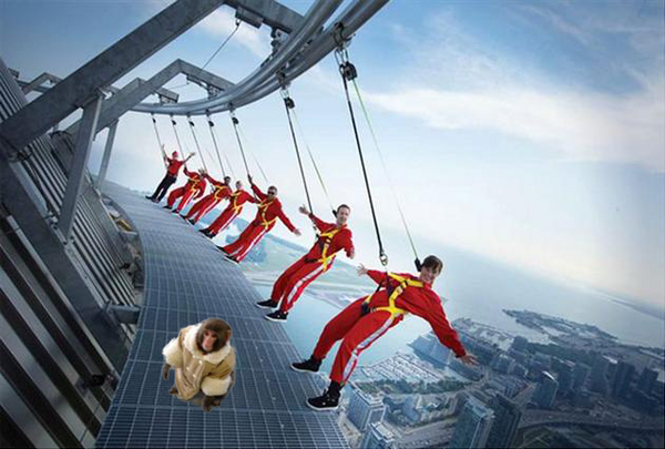 Well-dressed monkey follows up IKEA trip with visit to top of Toronto landmark. http://pic.twitter.com/xaoK0LKC
