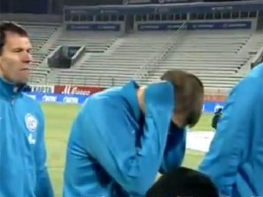 Russian Rebel? Zenits Igor Denisov blocks out the national anthem