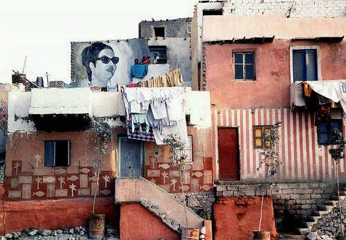how beautiful is this? Omm Kolthoum decorates the walls of a slum area, so tasteful :) http://t.co/DFLiBz8D