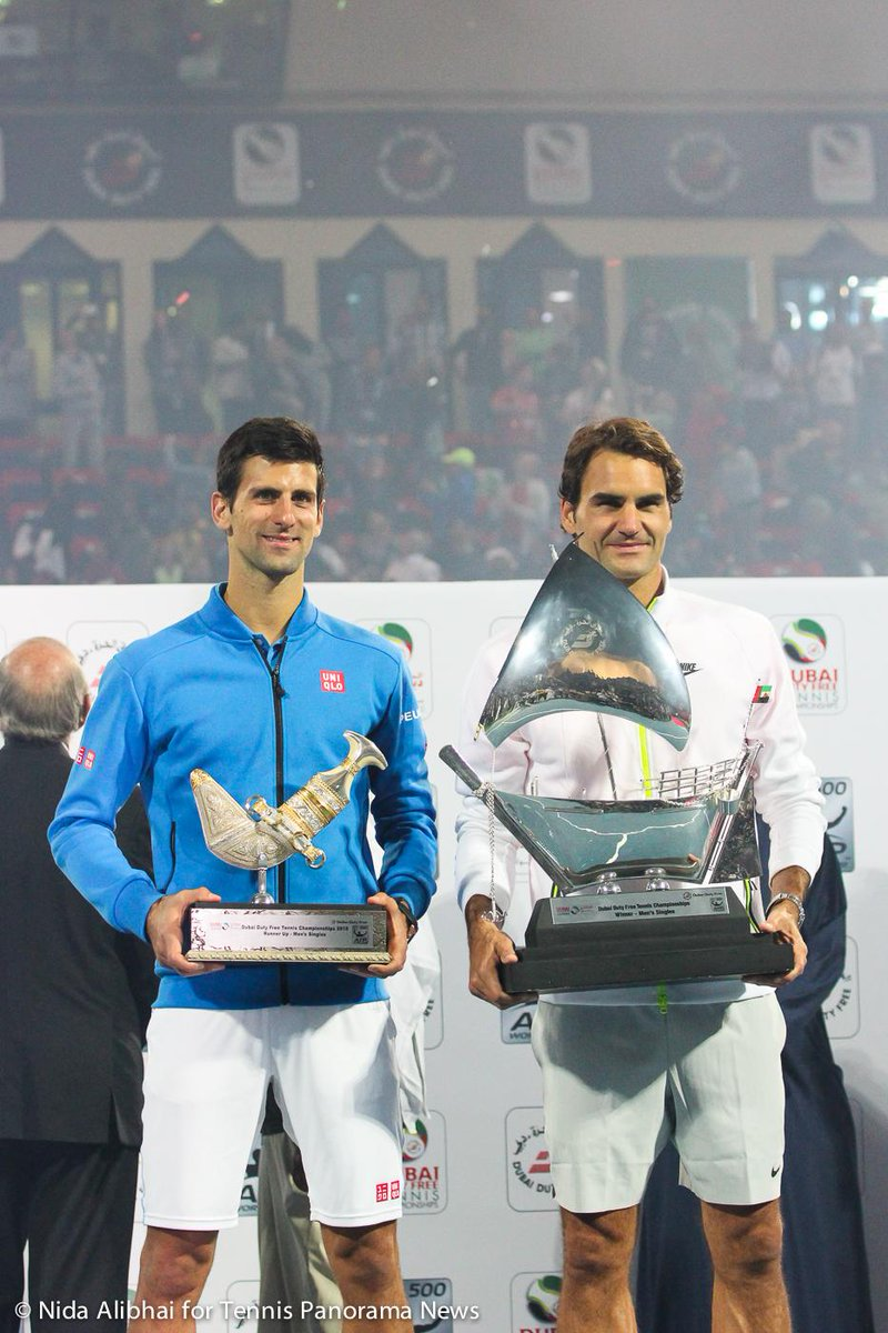 Djokovic and Federer with their trophies in Dubai. #DDFTennis http://t.co/Ob8idXwEMU