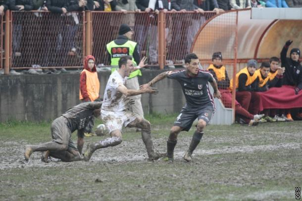 Velkoski watched the muddy game from the bench