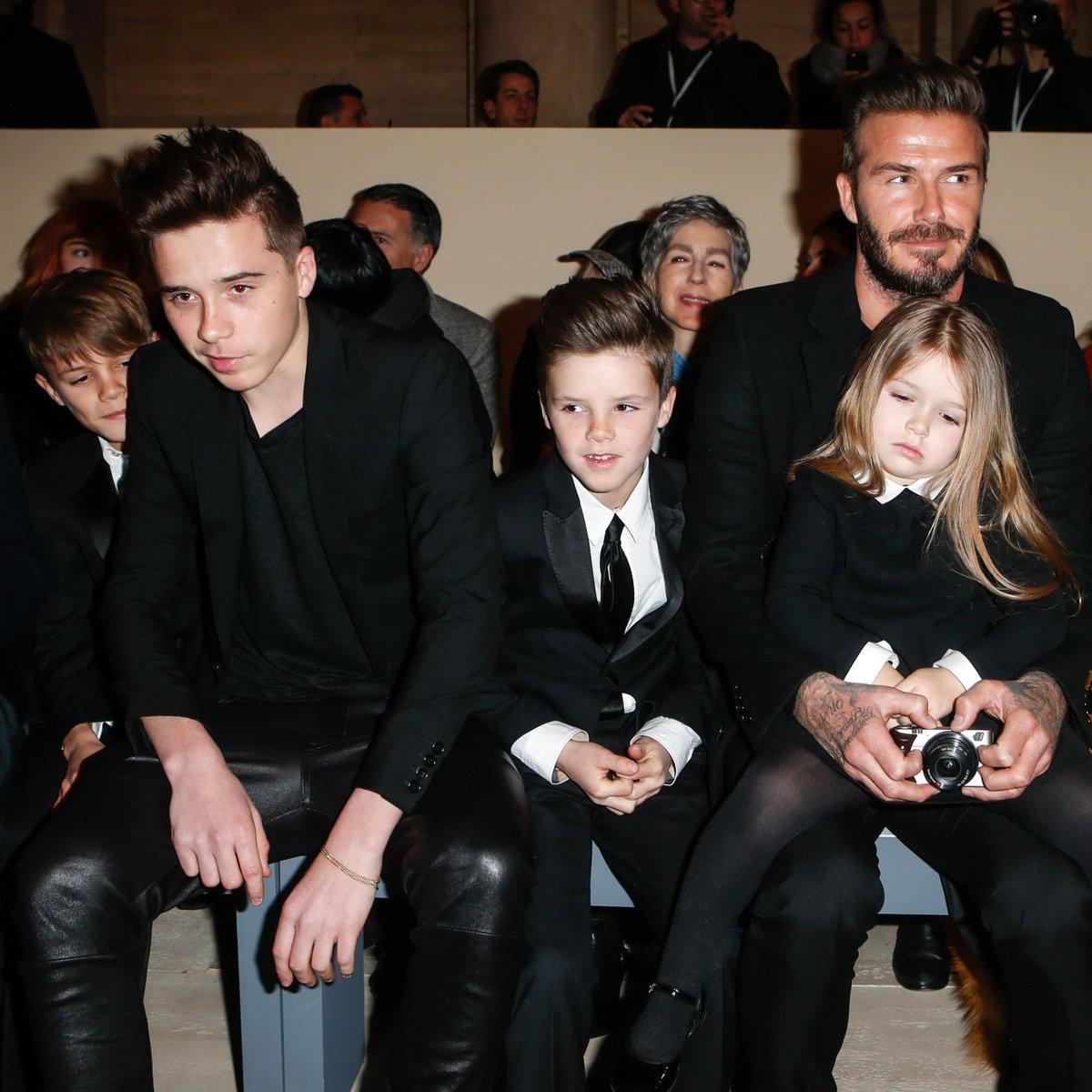David Beckham sits front row at wife Victoria Beckham's show. (Twitter/ @ELINNF_)